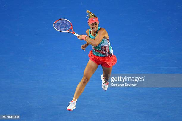 Angelique Kerber of Germany plays a backhand in her Women's Singles Final match against Serena Williams of the United States during day 13 of the...