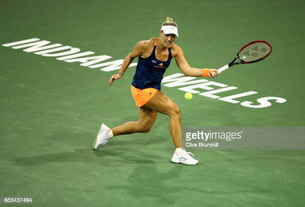 Angelique Kerber of Germany plays a forehand against Elena Vesnina of Russia in their fourth round match during day nine of the BNP Paribas Open at...