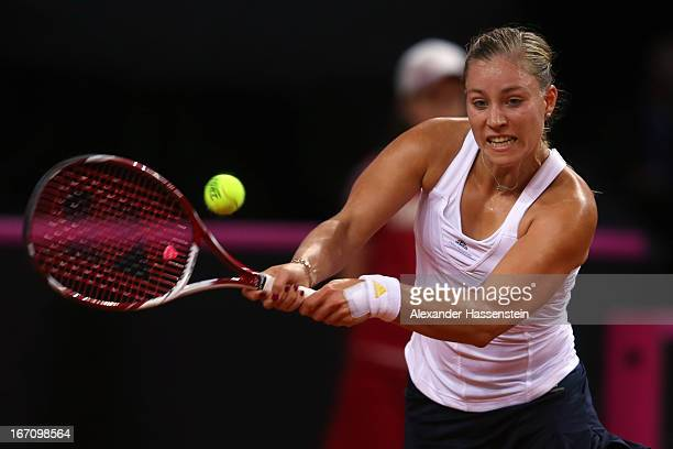 Angelique Kerber of Germany plays a forehand during her match against Bojana Jovanovski of Serbia at the Fed Cup World Group Play off between Germany...