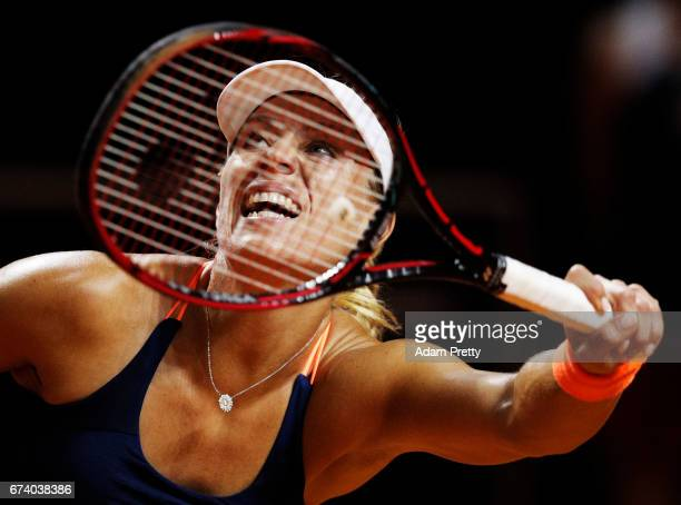 Angelique Kerber of Germany plays a forehand during her match against Kristina Mladenovic of France during the Porsche Tennis Grand Prix at Porsche...