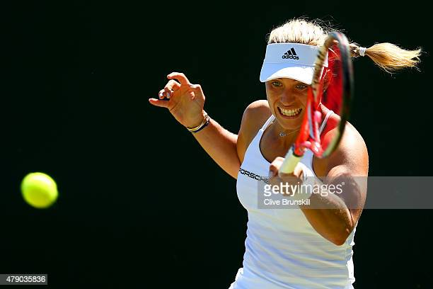 Angelique Kerber of Germany plays a forehand in her Ladies Singles first round match against Carina Witthoeft of Germany during day two of the...