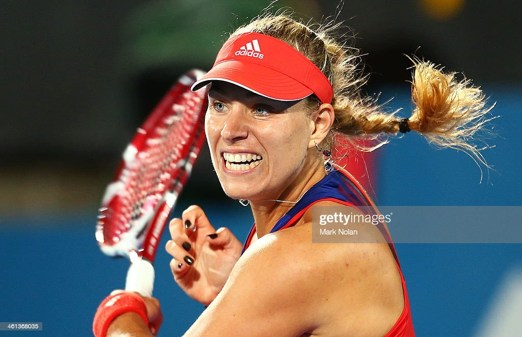 Angelique Kerber of Germany plays a forehand in her match against Carla Suarez Navarro of Spain during day four of the 2014 Sydney International at Sydney Olympic Park Tennis Centre on January 8, 2014 in Sydney, Australia.