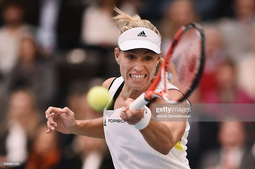 <a gi-track='captionPersonalityLinkClicked' href=/galleries/search?phrase=Angelique+Kerber&family=editorial&specificpeople=4307332 ng-click='$event.stopPropagation()'>Angelique Kerber</a> of Germany plays a forehand in her match against Belinda Bencic of Switzerland on Day 2 of the 2016 FedCup World Group Round 1 match between Germany and Switzerland at Messe Leipzig on February 7, 2016 in Leipzig, Germany.