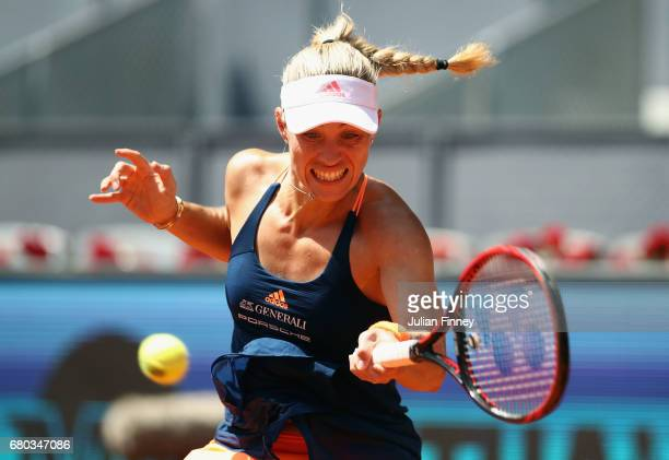 Angelique Kerber of Germany plays a forehand in her match against Katerina Siniakova of Czech Republic during day three of the Mutua Madrid Open...
