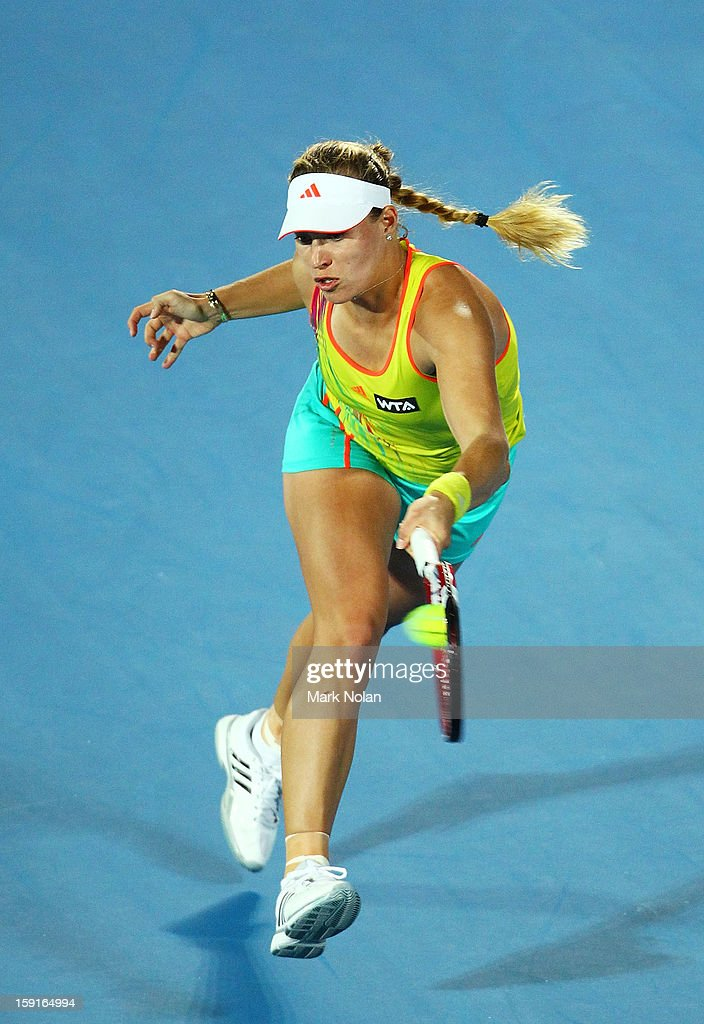 Angelique Kerber of Germany plays a forehand in her quarter final match against Svetlana Kuznetsova of Russia during day four of the Sydney International at Sydney Olympic Park Tennis Centre on January 9, 2013 in Sydney, Australia.