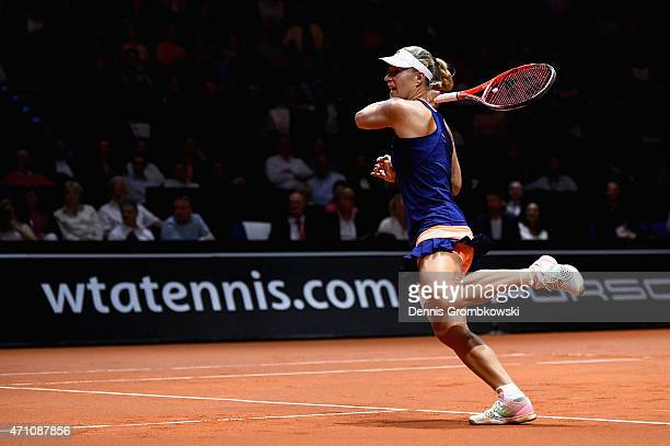 Angelique Kerber of Germany plays a forehand in her semi final match against Madison Brengle of the United States during Day 6 of the Porsche Tennis...
