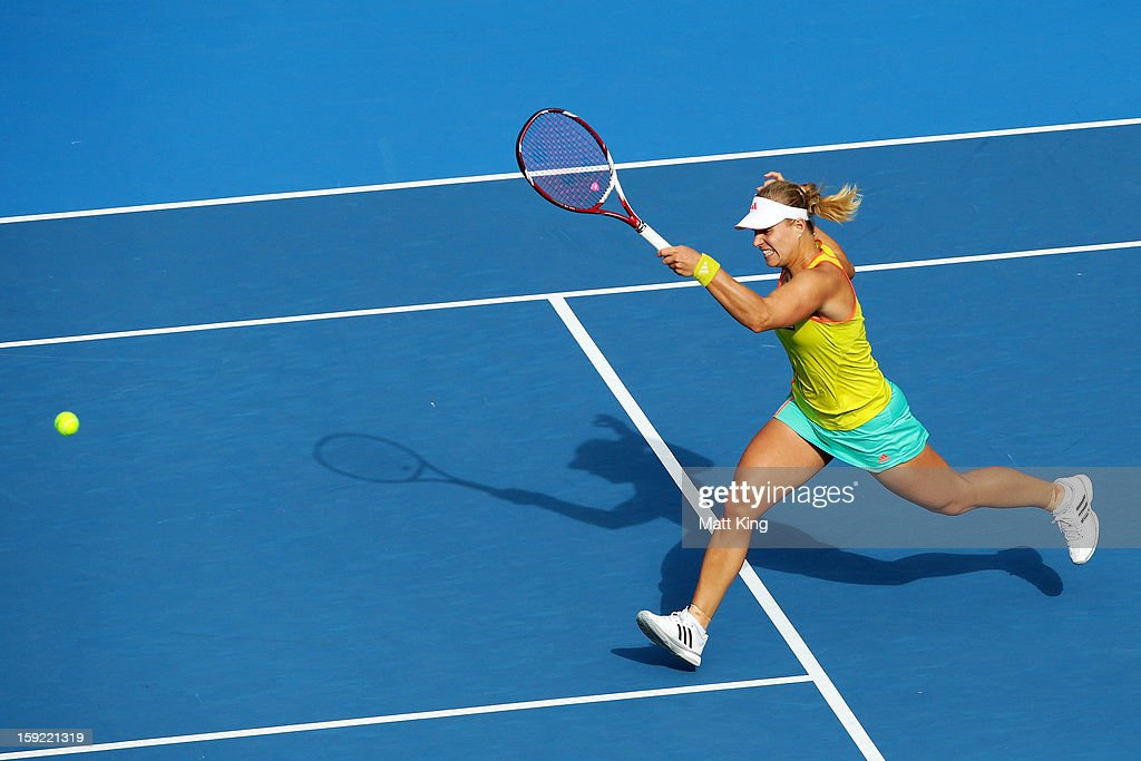 Angelique Kerber of Germany plays a forehand while running towards the net in her semi final match against Dominika Cibulkova of Slovakia during day five of the Sydney International at Sydney Olympic Park Tennis Centre on January 10, 2013 in Sydney, Australia.