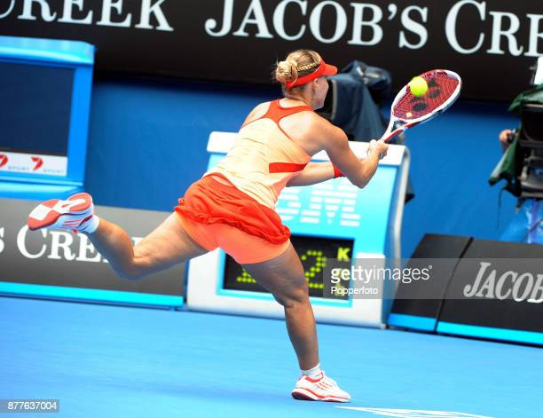 Angelique Kerber of Germany plays a lob return with her back to the net against Maria Sharapova of Russia during a Ladies Singles 3rd round match on...