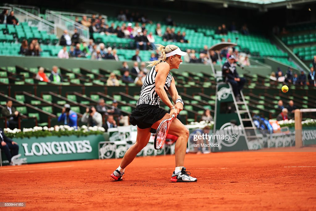 Angelique Kerber of Germany plays a shot during the Women's Singles first round match against kiki Bertens of Netherlands on day three of the 2016 French Open at Roland Garros on May 24, 2016 in Paris, France .