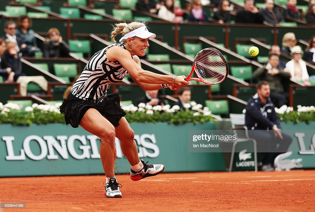 <a gi-track='captionPersonalityLinkClicked' href=/galleries/search?phrase=Angelique+Kerber&family=editorial&specificpeople=4307332 ng-click='$event.stopPropagation()'>Angelique Kerber</a> of Germany plays a shot during the Women's Singles first round match against kiki Bertens of Netherlands on day three of the 2016 French Open at Roland Garros on May 24, 2016 in Paris, France .