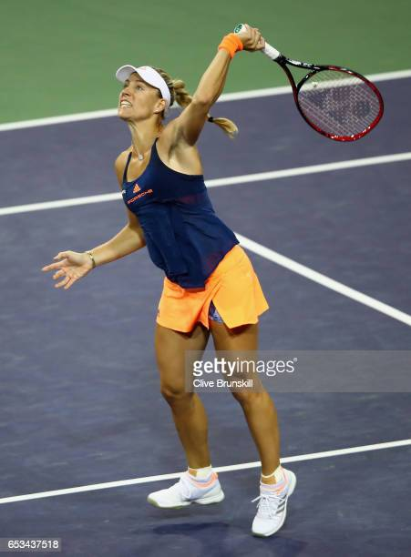 Angelique Kerber of Germany plays a smash against Elena Vesnina of Russia in their fourth round match during day nine of the BNP Paribas Open at...