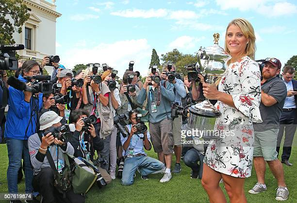 Angelique Kerber of Germany poses for photographers as she holds the Daphne Akhurst Memorial Cup during a photocall at Government House after winning...