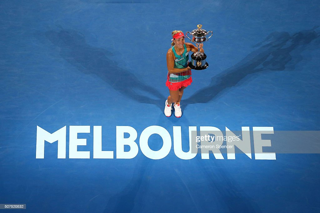 Angelique Kerber of Germany poses with the Daphne Akhurst Trophy after winning the Women's Singles Final against Serena Williams of the United States during day 13 of the 2016 Australian Open at Melbourne Park on January 30, 2016 in Melbourne, Australia.