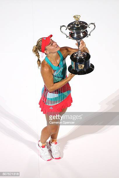 Angelique Kerber of Germany poses with the Daphne Akhurst Trophy after winning the Women's Singles Final against Serena Williams of the United States...