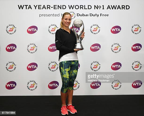 Angelique Kerber of Germany poses with the DDF YearEnd World No1 trophy during day 3 of the BNP Paribas WTA Finals Singapore at Singapore Sports Hub...