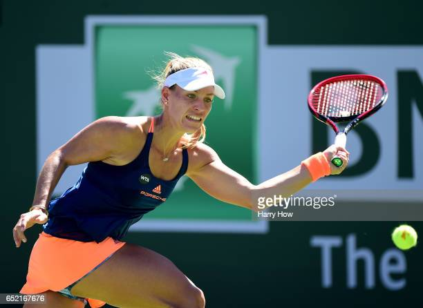 Angelique Kerber of Germany prepares to hit a forehand during her straight set win over Andrea Petkovic of Germany at Indian Wells Tennis Garden on...