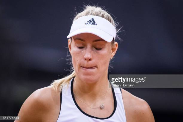 Angelique Kerber of Germany reacts after missing a point against Elina Svitolona of Ukraine during the FedCup World Group PlayOff match between...