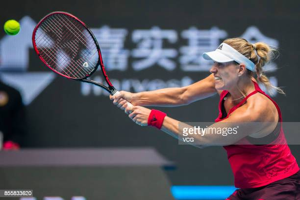 Angelique Kerber of Germany reacts against Naomi Osaka of Japan during the first round match of Women's singles match on day one of 2017 China Open...