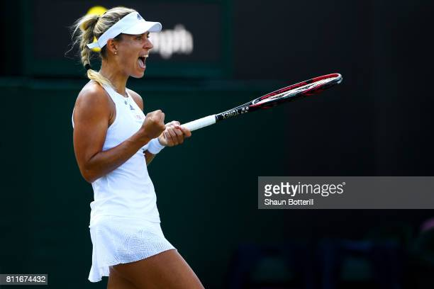 Angelique Kerber of Germany reacts during the Ladies Singles fourth round match against Garbine Muguruza of Spain on day seven of the Wimbledon Lawn...