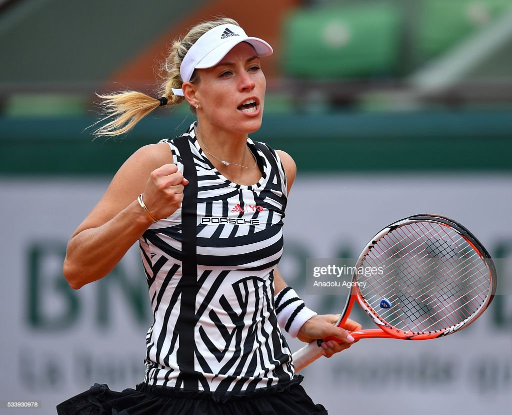 Angelique Kerber of Germany reacts during the match against Kiki Bertens of the Netherlands, during their women's single first round match at the French Open tennis tournament at Roland Garros in Paris on May 24, 2016.
