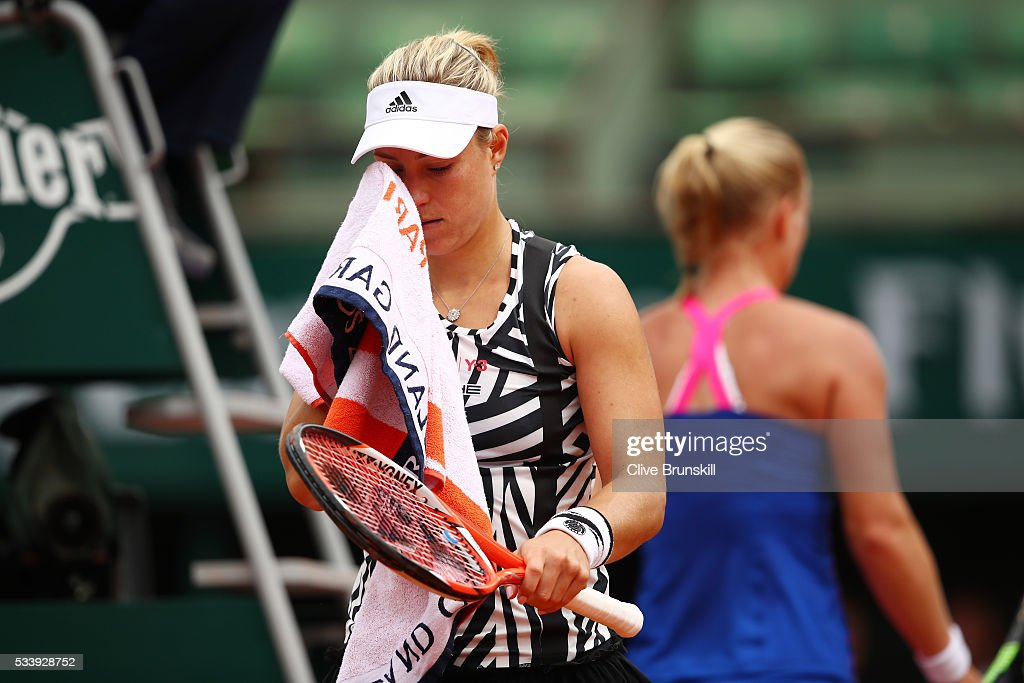 <a gi-track='captionPersonalityLinkClicked' href=/galleries/search?phrase=Angelique+Kerber&family=editorial&specificpeople=4307332 ng-click='$event.stopPropagation()'>Angelique Kerber</a> of Germany reacts during the Women's Singles first round match against Kiki Bertens of the Netherlands on day three of the 2016 French Open at Roland Garros on May 24, 2016 in Paris, France.