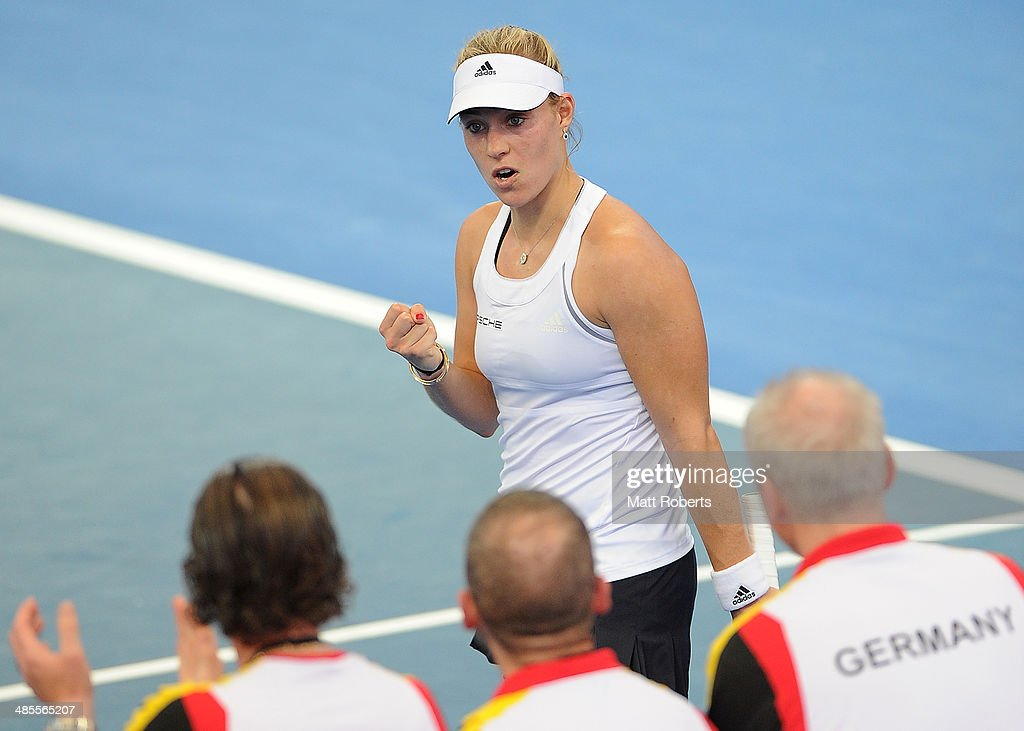 <a gi-track='captionPersonalityLinkClicked' href=/galleries/search?phrase=Angelique+Kerber&family=editorial&specificpeople=4307332 ng-click='$event.stopPropagation()'>Angelique Kerber</a> of Germany reacts in her match against Casey Dellacqua of Australia during the Fed Cup Semi Final tie between Australia and Germany at Pat Rafter Arena on April 19, 2014 in Brisbane, Australia.