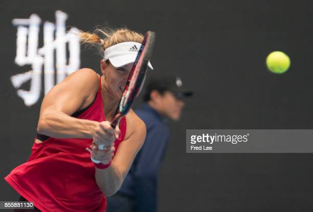 Angelique Kerber of Germany returns a backhand during the match against Naomi OSAKA of Japan of the 2017 China Open at the China National Tennis...