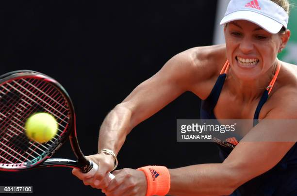 TOPSHOT Angelique Kerber of Germany returns a ball to Estonia's Anett Kontaveit during the WTA Tennis Open tournament at the Foro Italico on May 17...