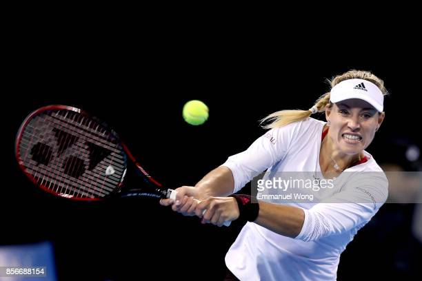 Angelique Kerber of Germany returns a shot against Alize Cornet on day three of the 2017 China Open at the China National Tennis Centre on October...