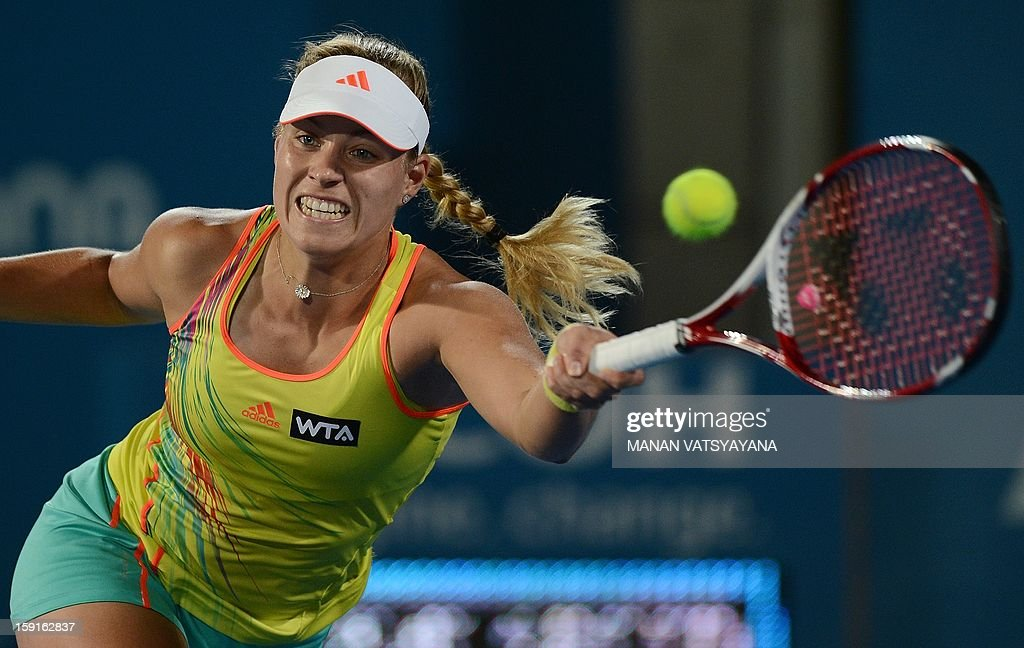 Angelique Kerber of Germany returns a shot against Svetlana Kuznetsova of Russia during their quarter-final match of the Sydney International tennis tournament on January 9, 2013.