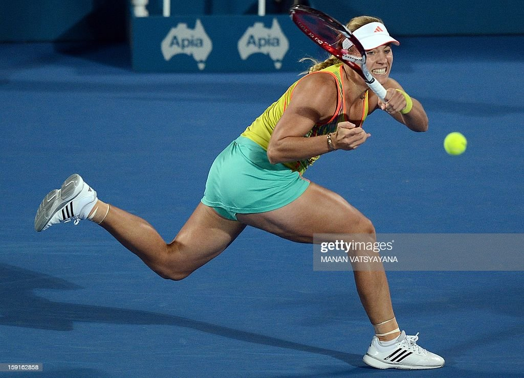 Angelique Kerber of Germany returns a shot against Svetlana Kuznetsova of Russia during their quarter-final match of the Sydney International tennis tournament on January 9, 2013. AFP PHOTO/ MANAN VATSYAYANA USE