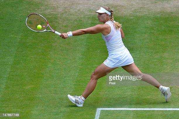 Angelique Kerber of Germany returns a shot during her Ladies' Singles semi final match against Agnieszka Radwanska of Poland on day ten of the...