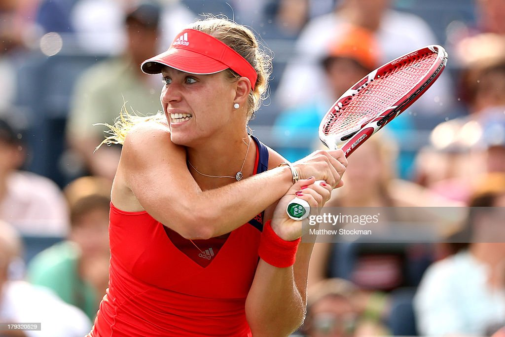 <a gi-track='captionPersonalityLinkClicked' href=/galleries/search?phrase=Angelique+Kerber&family=editorial&specificpeople=4307332 ng-click='$event.stopPropagation()'>Angelique Kerber</a> of Germany returns a shot during her women's singles fourth round match against Carla Suarez Navarro of Spain on Day Seven of the 2013 US Open at USTA Billie Jean King National Tennis Center on September 1, 2013 in the Flushing neighborhood of the Queens borough of New York City.