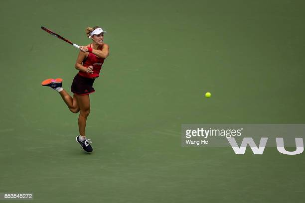 Angelique Kerber of Germany returns a shot during the match against Caroline Garcia of France on Day 2 of 2017 Dongfeng Motor Wuhan Open at Optics...