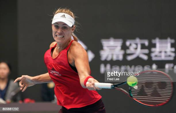 Angelique Kerber of Germany returns a shot during the match against Naomi OSAKA of Japan of the 2017 China Open at the China National Tennis Centre...