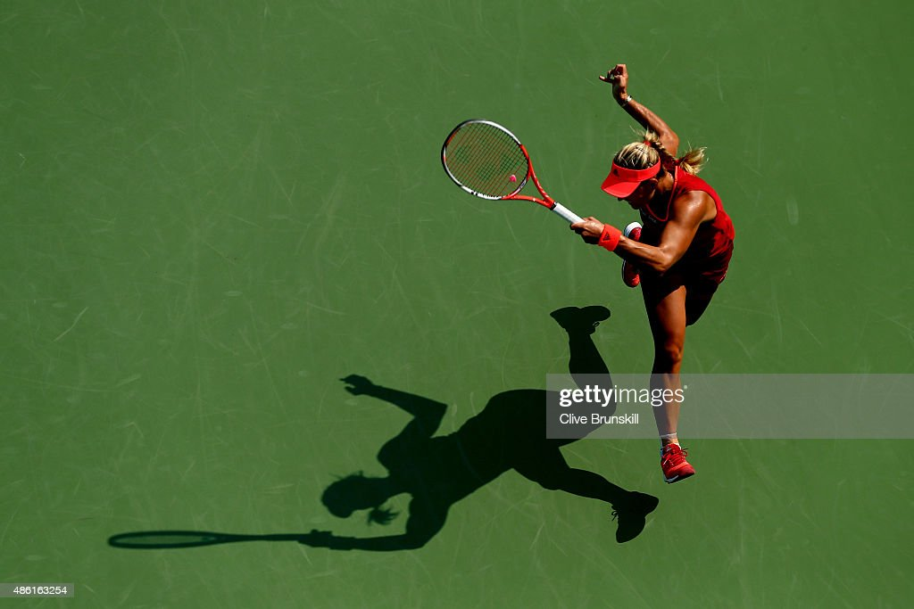Angelique Kerber of Germany returns a shot to Alexandra Dulgheru of Romania during their Women's Singles First Round match on Day Two of the 2015 US Open at the USTA Billie Jean King National Tennis Center on September 1, 2015 in the Flushing neighborhood of the Queens borough of New York City.