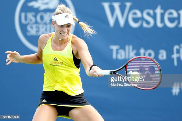 Angelique Kerber of Germany returns a shot to Ekaterina Makarova of Russia during day 5 of the Western Southern Open at the Lindner Family Tennis...