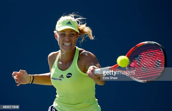 Angelique Kerber of Germany returns a shot to Karolina Pliskova of the Czech Republic during the finals on Day 7 of the Bank of the West Classic at...