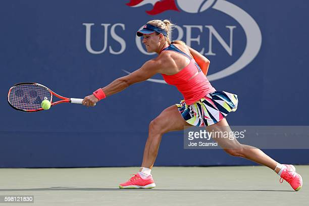 Angelique Kerber of Germany returns a shot to Mirjana LucicBaroni of Croatia during her second round Women's Singles match on Day Three of the 2016...