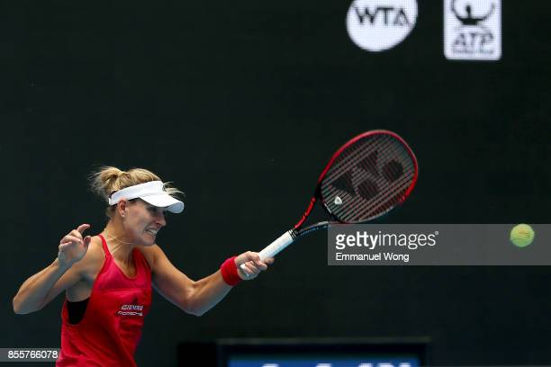 Angelique Kerber of Germany returns a shot to Naomi Osaka of japan on day one of the 2017 China Open at the China National Tennis Centre on September...