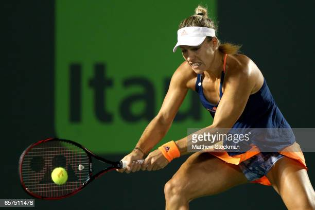 Angelique Kerber of Germany returns a shot to YingYing Duan of China during the Miami Open at the Crandon Park Tennis Center on March 24 2017 in Key...