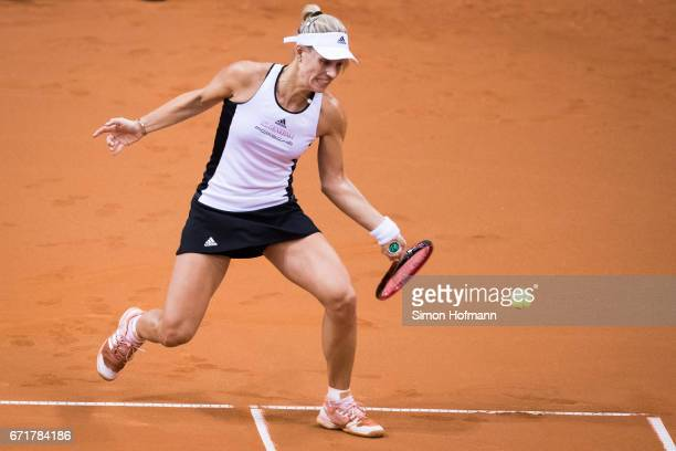 Angelique Kerber of Germany returns the ball against Elina Svitolina of Ukraine during the FedCup World Group PlayOff match between Germany and...