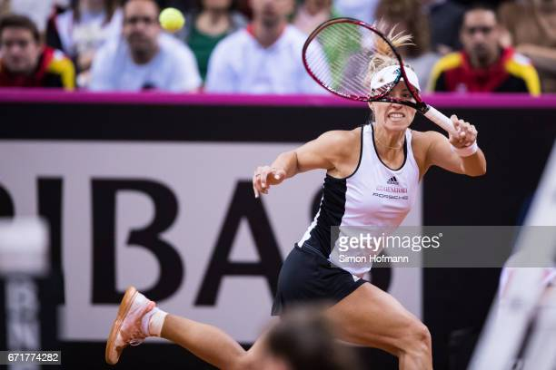 Angelique Kerber of Germany returns the ball against Elina Svitolona of Ukraine during the FedCup World Group PlayOff match between Germany and...