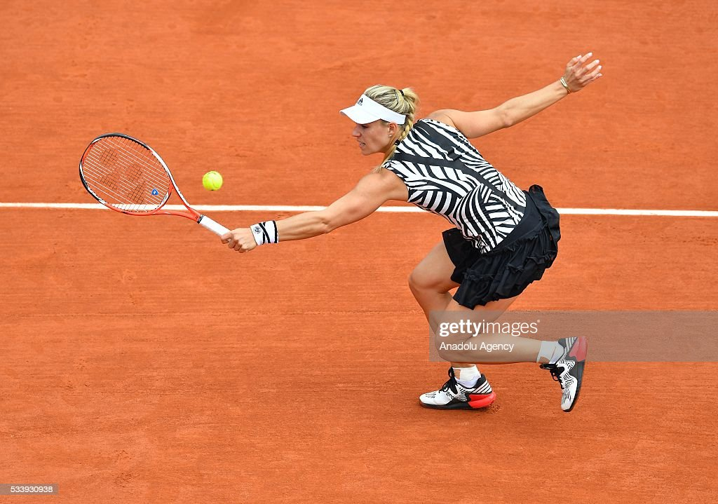 Angelique Kerber of Germany returns the ball to Kiki Bertens of the Netherlands during their women's single first round match at the French Open tennis tournament at Roland Garros in Paris on May 24, 2016.