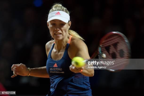 Angelique Kerber of Germany returns the ball to Kristina Mladenovic of France during the Porsche Tennis Grand Prix at Porsche Arena in Stuttgart...