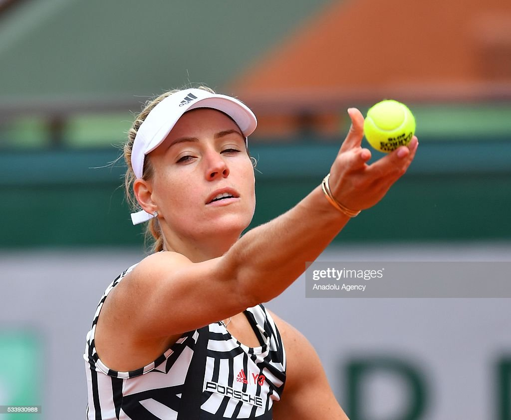 Angelique Kerber of Germany serves against Kiki Bertens of the Netherlands during their women's single first round match at the French Open tennis tournament at Roland Garros in Paris on May 24, 2016.