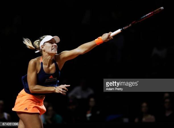 Angelique Kerber of Germany serves during her match against Kristina Mladenovic of France during the Porsche Tennis Grand Prix at Porsche Arena on...