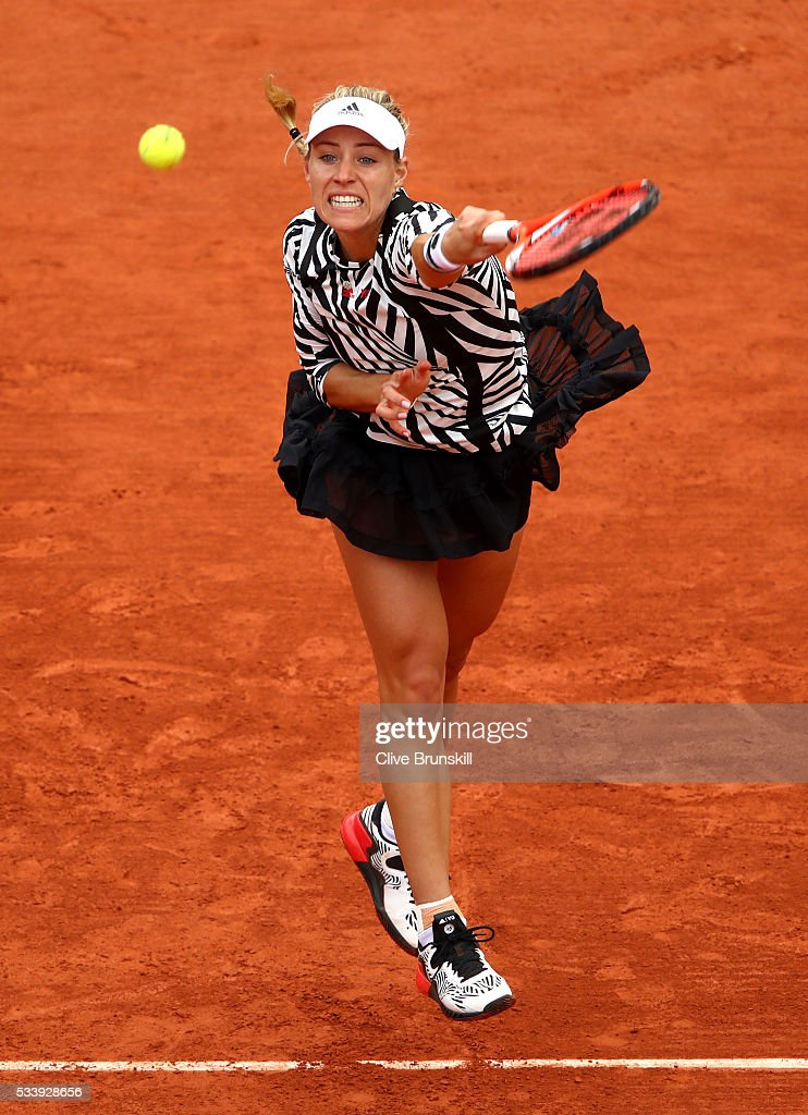 <a gi-track='captionPersonalityLinkClicked' href=/galleries/search?phrase=Angelique+Kerber&family=editorial&specificpeople=4307332 ng-click='$event.stopPropagation()'>Angelique Kerber</a> of Germany serves during the Women's Singles first round match against Kiki Bertens of the Netherlands on day three of the 2016 French Open at Roland Garros on May 24, 2016 in Paris, France.