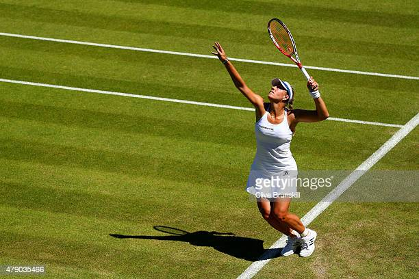 Angelique Kerber of Germany serves in her Ladies Singles first round match against Carina Witthoeft of Germany during day two of the Wimbledon Lawn...