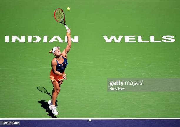 Angelique Kerber of Germany serves in her match against Andrea Petkovic of Germany at Indian Wells Tennis Garden on March 11 2017 in Indian Wells...